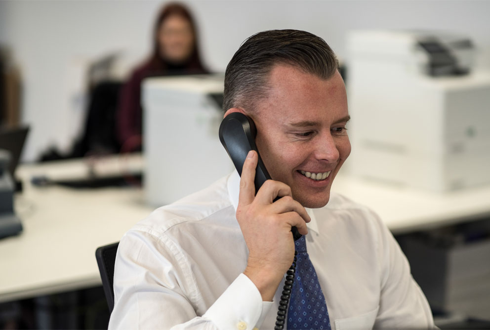An insurance scanning representative talking with a client over the telephone